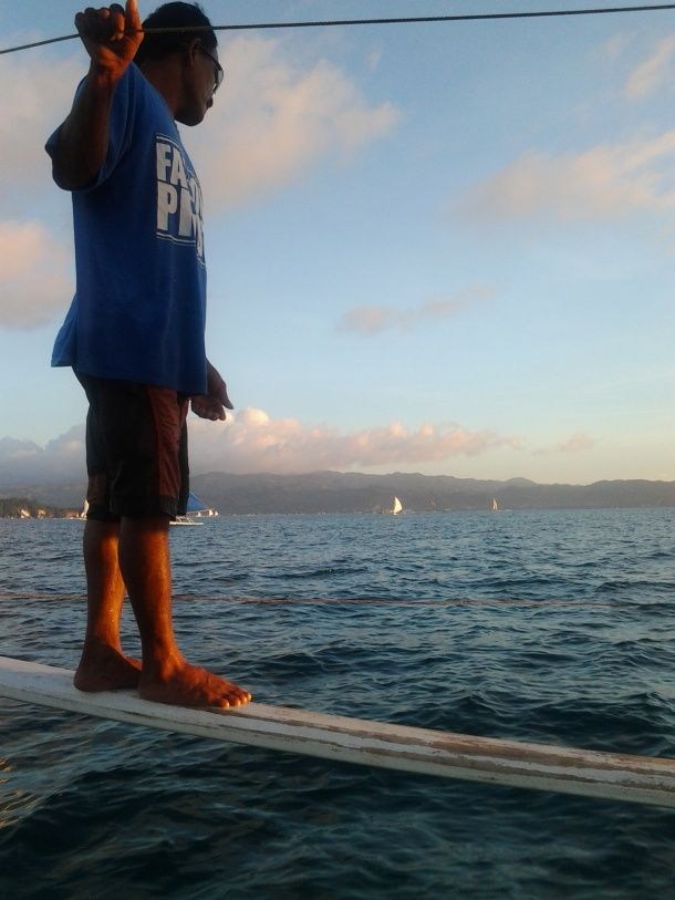 Kuya Eddie, the Boatman Arranges the Sails